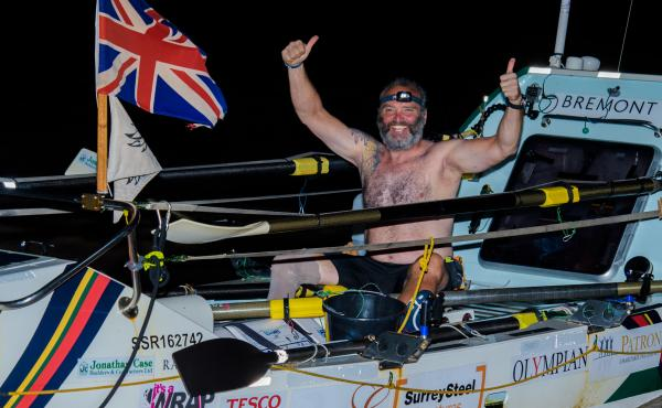 Lee Spencer, a 49-year-old single-leg amputee, celebrates after rowing solo across the Atlantic.