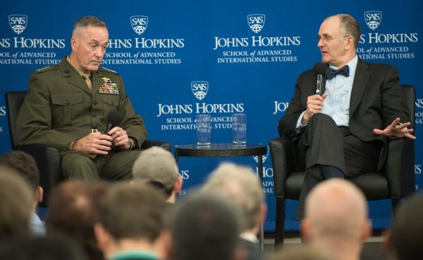 Eliot Cohen, director of the Strategic Studies program, poses a question to U.S. Marine Corps Gen. Joseph F. Dunford, Jr., chairman of the Joint Chiefs of Staff, at the Johns Hopkins University School of Advanced International Studies.