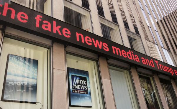 Fox News ceased broadcasting in the UK on Tuesday. Its parent company, 21st Century Fox, is trying to get government approval for its takeover bid of European media giant Sky. Above, headlines scroll across the Fox News studios in New York earlier this mo