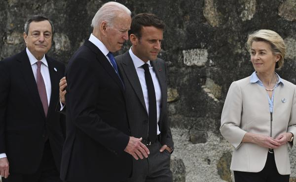 Back in June at the G-7 summit in England, French President Emmanuel Macron (center, right) and President Biden appeared to be getting along fine. They spoke Wednesday after a rift that began with a new security alliance.