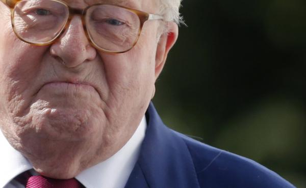 French far-right National Front founder Jean-Marie Le Pen arrives for a news briefing at party headquarters in Nanterre, near Paris, on Thursday. The executive committee decided to expel Le Pen from the party over remarks downplaying the Holocaust.