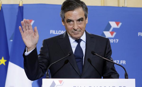 Francois Fillon waves before delivering a speech after the conservative presidential primary on Nov. 27, in Paris.