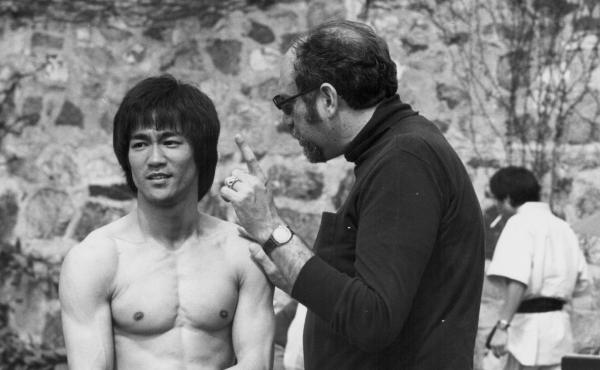 Actor Bruce Lee with producer Fred Weintraub, on the set Enter the Dragon in 1973.