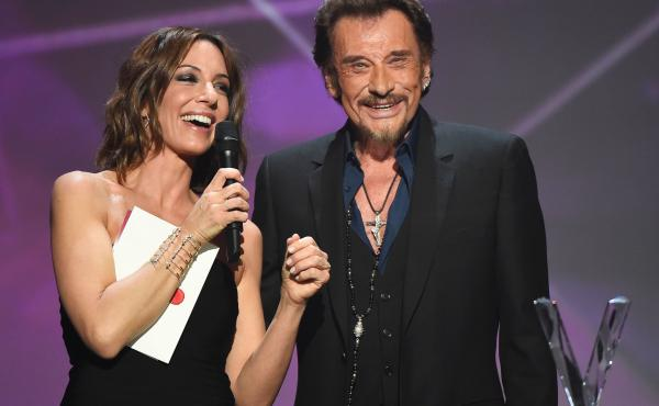 French singer Johnny Hallyday smiles as he receives the best album award next to French TV host Virginie Guilhaume at the 31st Victoires de la Musique, the annual French music awards ceremony, last year at the Zenith concert hall in Paris.