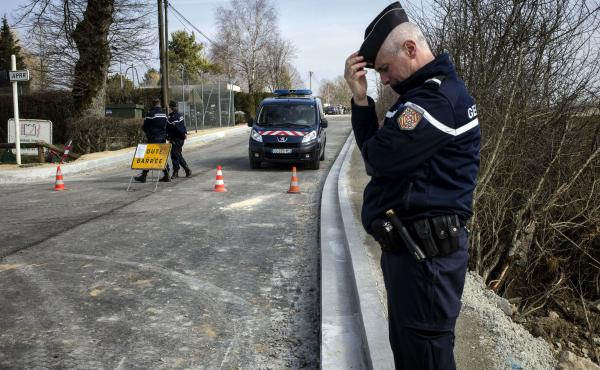 A French gendarme stands guard Wednesday in Avallon after thieves attacked two armored vans carrying jewels overnight.