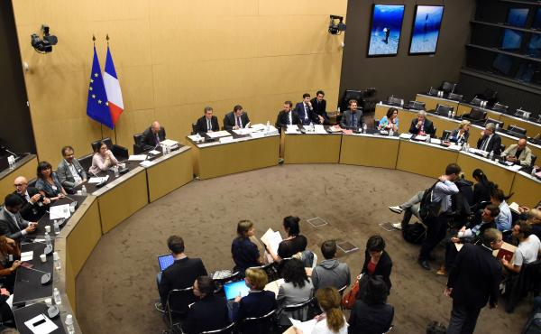 The president of the commission of inquiry, former judge Georges Fenech (center left) and Socialist lawmaker Sebastien Pietrasanta (center right) look on during a press conference in Paris on Tuesday to present the conclusions of French inquiry into the t