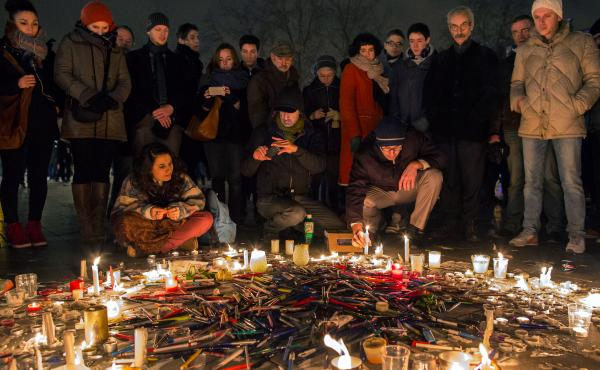 Pens are thrown on the ground during a vigil in Paris following a deadly attack at the offices of Charlie Hebdo, the weekly satirical magazine.