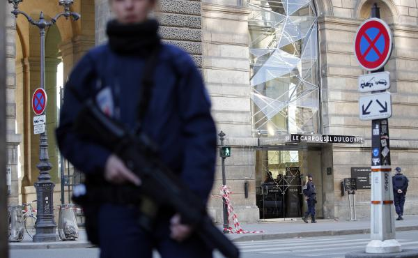 Officers cordon off an area outside the Louvre Museum near the shopping area where a man attacked soldiers in Paris on Friday.