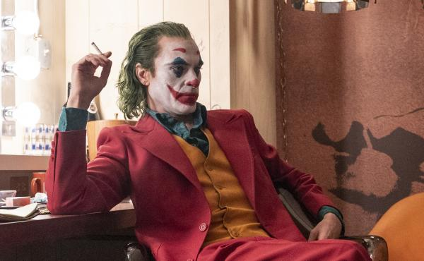 Joaquin Phoenix is Arthur Fleck, a party clown and aspiring stand-up comic who struggles with mental illness and turns violent in Joker.