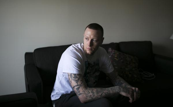 Bad grades, injuries and drugs nearly ended Nick Minnerath's basketball career before it even began. Here, he sits in his apartment in Canton, Ohio, where last season he played forward for the Canton Charge, a team in the NBA's minor league, or D-League.