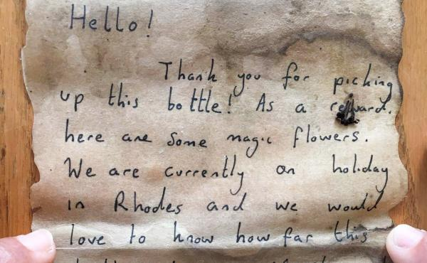 An English couple on vacation in Greece composed this note, rolled it up in a bottle and, on July 4, tossed it into the Mediterranean Sea. A Palestinian fisherman caught it in his net this week. He says it's the first piece of personal mail he has ever re