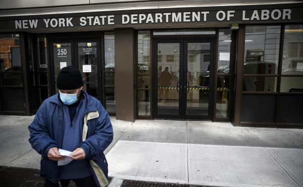 Visitors to the New York Department of Labor are turned away at the door by personnel because of closures over coronavirus concerns in New York on March 18. New York state began offering job protections for those required, or cautioned, to self-isolate or