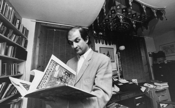 British writer Salman Rushdie leafs through a book in his study. He went into hiding for years after the Iranian leader Ayatollah Khomeini issued a fatwa calling for his death in 1989. The ayatollah denounced Rushdie's portrayal of the Prophet Muhammad in