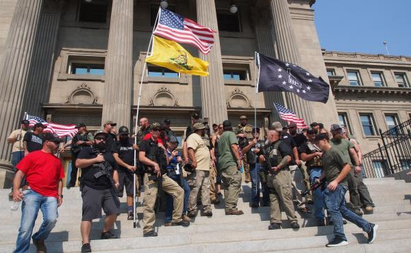 Gun rights supporters, including militia members, rally in support of gun rights in September 2018 during an event put on by the Idaho Second Amendment Alliance. The alliance and groups like it around the country have been pushing back against efforts to