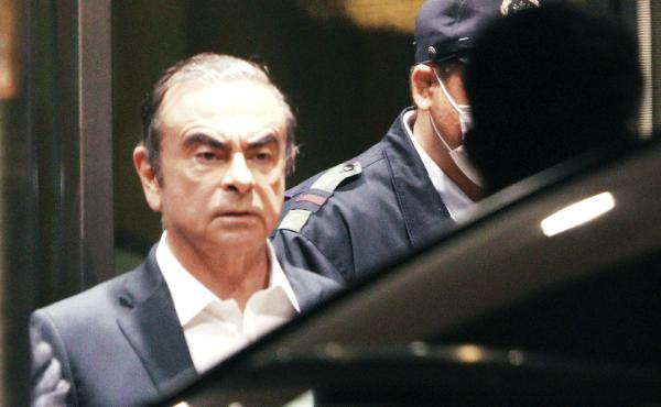 Former Nissan Chairman Carlos Ghosn, pictured leaving the Tokyo Detention Center in April, is believed to have escaped with the help of several individuals. So far, Turkish authorities have arrested 12 people in connection with the auto executive's getawa