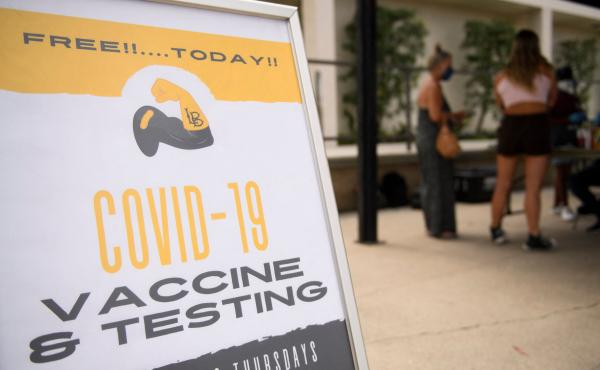 The city of Long Beach sets up COVID-19 vaccination and testing site at the California State University, Long Beach. More than 800 colleges and universities have now adopted COVID-19 vaccination requirements for their students and staff to be able to retu