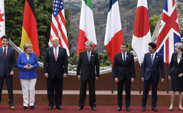 From left, Canadian Prime Minister Justin Trudeau, German Chancellor Angela Merkel, U.S. President Donald Trump, Italian Prime Minister Paolo Gentiloni, French President Emmanuel Macron, Japan's Prime Minister Shinzo Abe, and British Prime Minister Theres