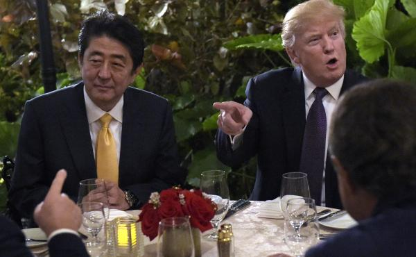 President Trump hosts Japanese Prime Minister Shinzo Abe last month at Mar-a-Lago in Palm Beach, Fla. North Korea tested a missile during Abe's visit and guests at the club overhead the two leaders discussing the incident.