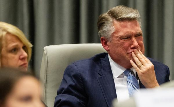 Mark Harris, Republican candidate in North Carolina's 9th Congressional race, fights back tears at the conclusion of his son John Harris's testimony during the third day of a North Carolina State Board of Elections hearing on the 9th Congressional Distric