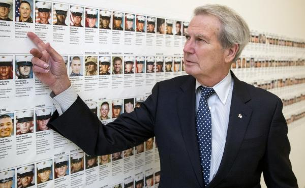 In this file photo, U.S. Rep. Walter Jones, R-N.C., stands in front of photos of fallen soldiers, along a hallway leading to his office on Capitol Hill in Washington. Jones, a once-fervent supporter of the 2003 invasion of Iraq who later became an equally