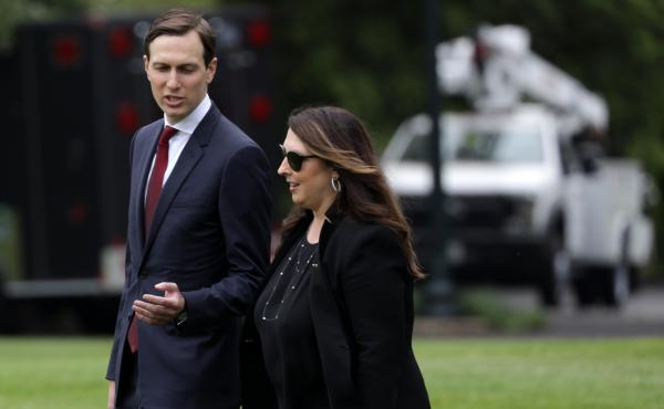 "Republican National Committee Chair Ronna McDaniel walks with White House senior adviser Jared Kushner on the South Lawn of the White House in May. She is describing the August convention as a ""convention celebration."""