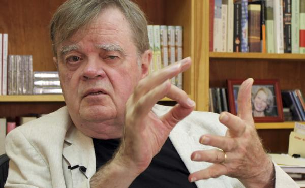 Garrison Keillor, creator and former host of A Prairie Home Companion, talks at his St. Paul, Minn., office in July. Minnesota Public Radio has announced it is cutting ties with Keillor and his production company owing to allegations of inappropriate beha