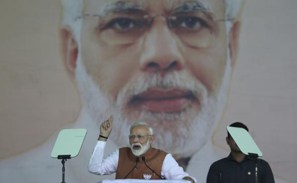 In this March 28 photo, Indian Prime Minister Narendra Modi addresses a campaign rally in Meerut. One of his efforts as prime minister has been to construct millions of toilets to reduce open defecation.