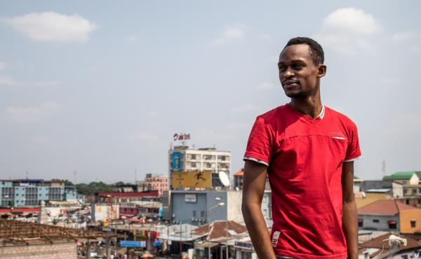Patou Izai stands on the roof above the office of the radio show he produces in Kinshasa, capital of Democratic Republic of Congo, for the LGBTI community.