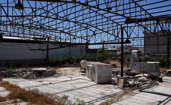 Faysal Shawa's warehouse was damaged in the 2014 conflict. Shawa and employees maintain no connection to Hamas.