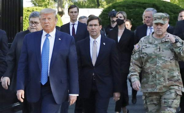 "Gen. Mark Milley (right) appears with President Trump as he departs the White House en route to St. John's Church on June 1. Milley now says his presence ""created a perception of the military involved in domestic politics."""