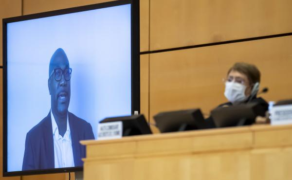 Philonise Floyd speaks via video to the U.N. Human Rights Council in Geneva on Wednesday, weeks after the killing of his brother George incited widespread protests against police brutality. U.N. human rights chief Michelle Bachelet looks on behind her fac