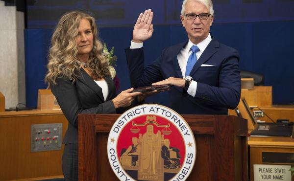 Los Angeles County District Attorney George Gascón is sworn in accompanied, by his wife Fabiola Kramsky. During his inaugural speech, he unveiled a series of criminal justice reforms that impact how prosecutors in his office pursue convictions, sentencin