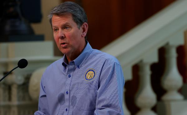 Georgia Gov. Brian Kemp speaks to the media during a news conference on April 27 in Atlanta.