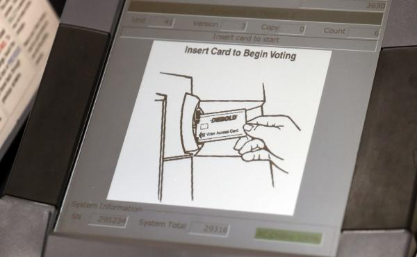 A touchscreen voting machine in Sandy Springs, Ga., during the primary election in May 2018. As the midterm congressional primaries heat up amid warnings of Russian hacking, about 1 in 5 Americans will be casting their ballots on machines that do not prod