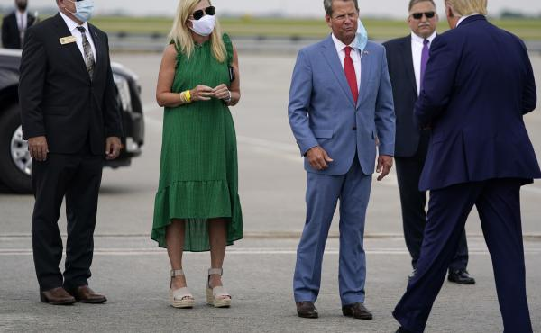 Georgia Gov. Brian Kemp (third from left) greets President Trump at Hartsfield-Jackson Atlanta International Airport on Wednesday.