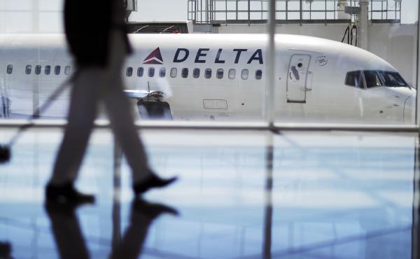 A Delta Air Lines jet sits at a gate at Hartsfield-Jackson Atlanta International Airport in Atlanta in October 2016.
