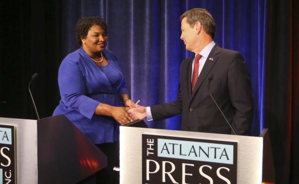 Democrat Stacey Abrams and Republican Brian Kemp greet each other before a debate last month in Atlanta.