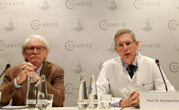 The CEO of Berlin's Charite Hospital, Karl Max Einhaeupl (left), and leading doctor Kai-Uwe Eckardt discuss the health of Pyotr Verzilov in Berlin on Tuesday. Verzilov, a member of Russian punk protest band Pussy Riot, was flown to Germany on Sept. 16 aft