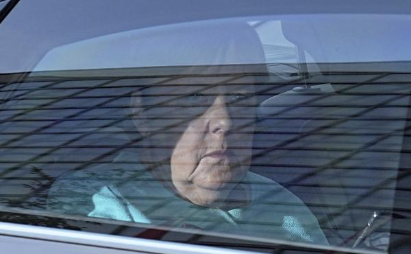 German Chancellor Angela Merkel arrives at the Konrad Adenauer House in Berlin, Germany, Sunday, Sept. 26, 2021. German voters are choosing a new parliament in an election that will determine who succeeds Chancellor Angela Merkel after her 16 years at the