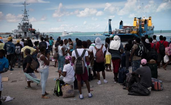 Several hundred Haitians and Bahamians wait at the port of Marsh Harbour in hopes of boarding a boat to Nassau on Friday.