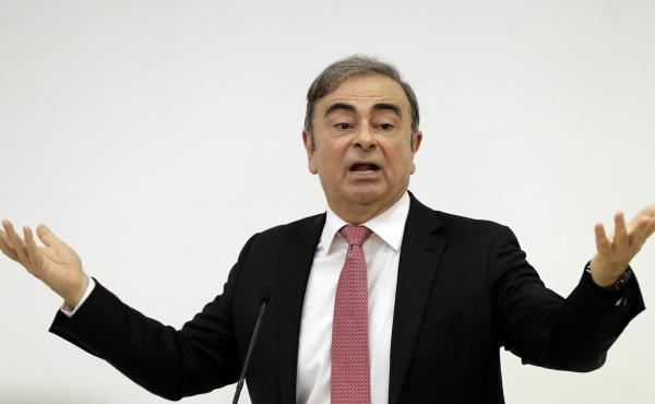 Former Nissan Chairman Carlos Ghosn addresses a news conference Wednesday in Beirut, during which he explained his reasons for dodging trial in Japan. The 65-year-old former auto executive, who is accused of financial misconduc, vowed to clear his name in