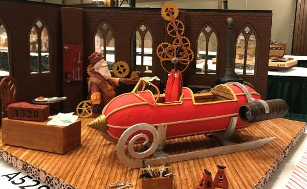 For this year's grand prize winner, the judges were impressed by the intricate, working gingerbread gears of the clock inside Santa's workshop.