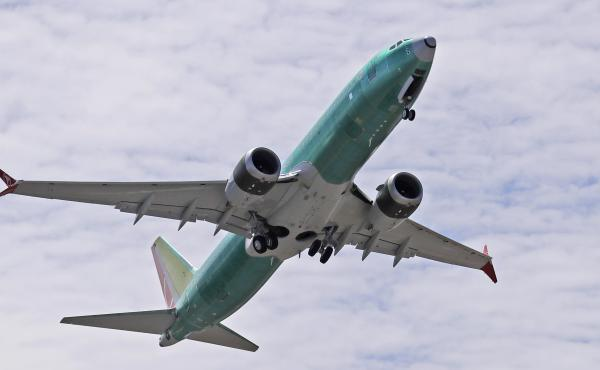 A Boeing 737 Max 8 jetliner being built for Turkish Airlines takes off on a test flight in Renton, Wash., on May 8. Passenger flights remain grounded worldwide as investigations continue into two fatal crashes involving the 737 Max aircraft.