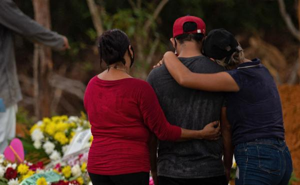 Relatives attend a COVID-19 victim's burial at a cemetery in Manaus, Amazonas state, Brazil, on Thursday.
