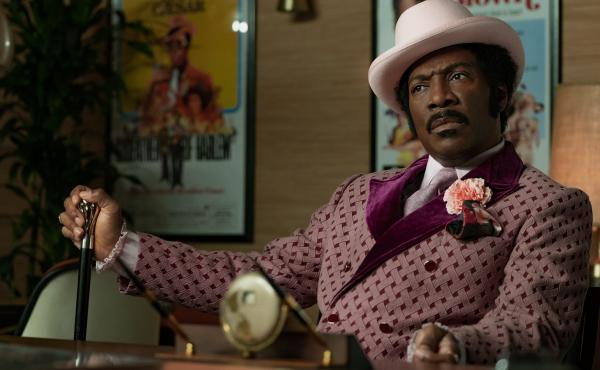 In Dolemite Is My Name, Eddie Murphy leads the star-studded biopic about Rudy Ray Moore, whose iconic alter ego became a blaxploitation legend.