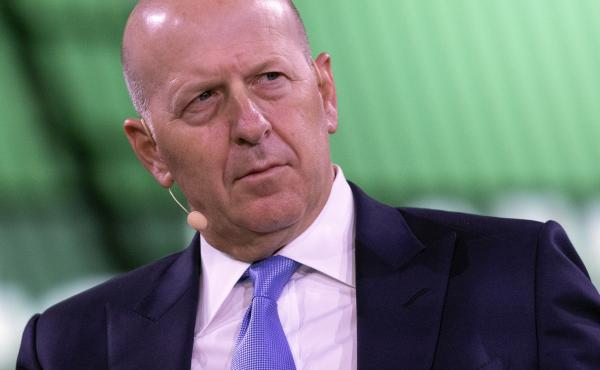 David Solomon, chairman and CEO of Goldman Sachs, shown here at a business roundtable in New York last year, is among several executives at the bank who will have to give back part of their pay.