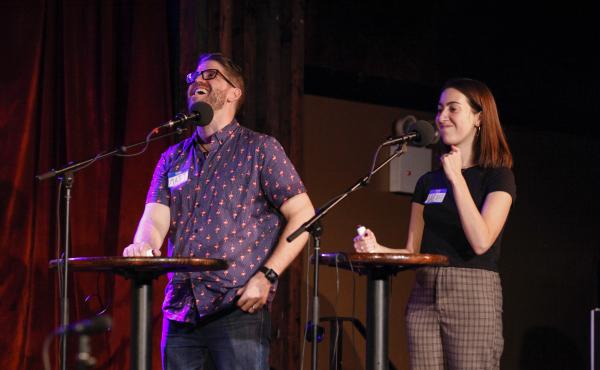 Contestants Matt Lyman and Sarah Gruber play a game on on Ask Me Another at the Bell House in Brooklyn, New York.