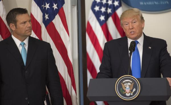 President Trump speaks alongside Kansas Secretary of State Kris Kobach during the first meeting of the Presidential Advisory Commission on Election Integrity in July.