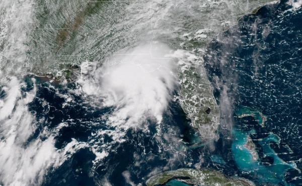 Gordon is predicted to become a hurricane before it makes landfall Tuesday night, bringing a dangerous storm surge. Gordon is seen here in a satellite image from around 1 p.m. CT Tuesday.
