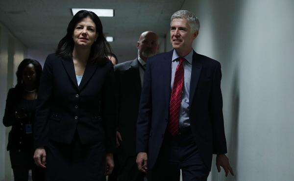 Supreme Court nominee Judge Neil Gorsuch (right) arrives with former Sen. Kelly Ayotte, R-N.H., for a meeting with Sen. Richard Blumenthal, D-Conn., Wednesday.